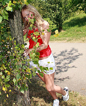 Daring horny teenager masturbates on a public road with toy