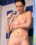 Busty naked teenager taking a horny masturbation shower