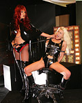 Strict mistress spanking a blonde slave with rubber toys