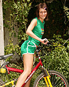 Brunette on a bike stopping for some outdoor masturbation