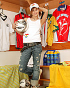 An erotic football teenager enjoys playing with herself