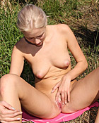 Cutie caressing her slippery clit with a small toy outdoors