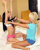 Two very horny teen lesbian hotties pleasuring eachother
