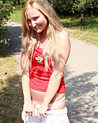 Cute chick stroking her snatch outside on a public road
