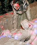 Two very hot teenage girls enjoy getting dirty in a mud tub