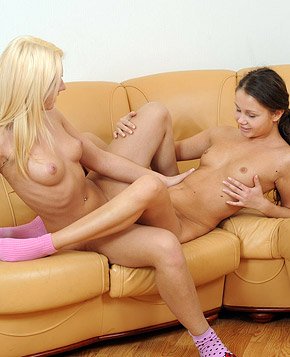 Two willing teenage lesbians fucking hardcore on a couch