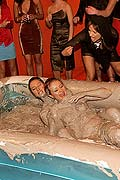 Two very hot lesbian babes duke it out in some thick mud