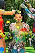 Three hot babes getting messy and naked with paint outside