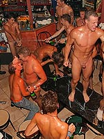 Huge group of gay men sucking and fucking in a dance club