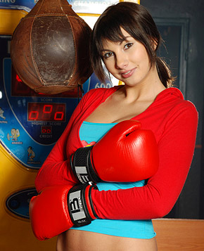 Cute boxing brunette masturbates her shaven cooch indoors