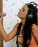 Hard rock chick sucking a rubber cock through a gloryhole