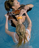 Sexy clothed lesbians enjoy shagging each other in the pool
