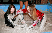 Very hot lesbian chicks wrestling in a pool of moist dirt