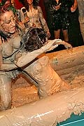 Topless muddy brunette wrestling babe winning the match