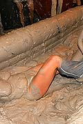 Hot babes tearing off their tops while wrestling in the mud