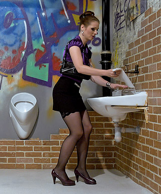 A clothed willing sweetheart drinking fake toilet spunk