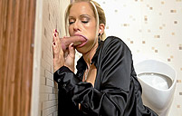 Horny girl finds small gloryhole and fucks the stiff penis