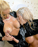 Two clothed blondes pleasuring a large fake stiff pecker