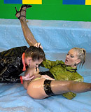 Two cute lesbian chicks enjoy playing with slippery goo