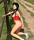 Cute horse riding babe stroking snatch with a red dildo