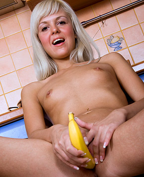Very cute blonde sticks banana in her soaked tight cunt