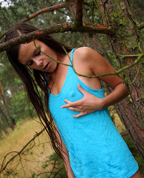 A gorgeous teenage brunette stroking cooch in the woods