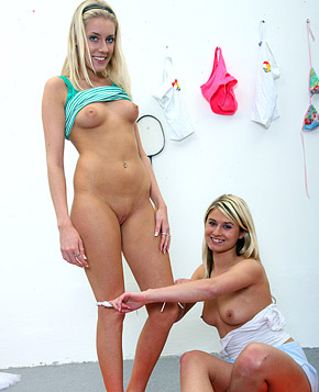 Two very sporty horny teenagers enjoy caressing each other