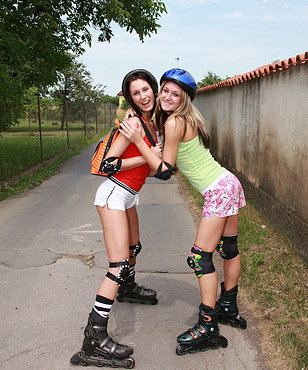 Two skating teen cuties love fondling each other outside