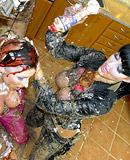 Three pretty horny babes covered in cream enjoy fondling