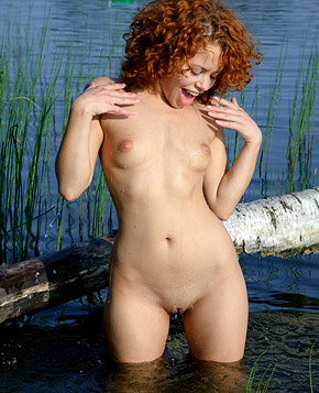 A very horny natural redhead pleasures her pussy outside