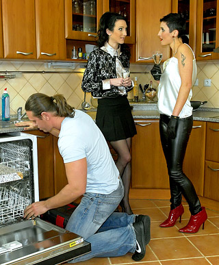 Hotshot banging two clothed babes in a big kitchen hard