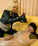 A clothed blindfolded blonde sucking his massive pecker