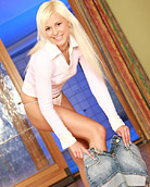 Blonde girl sitting on a massive dildo in the living room