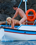Busty blond babe fucked in the ass on a fishing boat