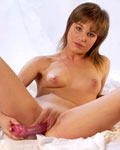 Teen Gaby Angel plays with two dildos