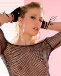 Jessy sexy blonde teen stripping in studio with fishnet lingerie!