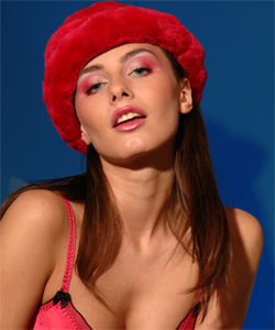 The wonderful Lola in a glamour strip-tease with an hat and sunglasses...
