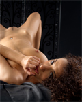 Loona Boheme arabic beauty on the black bed, nude with oil...