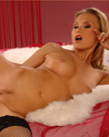 Michelle, hot blonde babe, playing with the big red dildo...