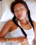 Stunning asian teen touching herself while she´s sleeping...