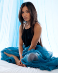 Terrific asian Angel called Yoko stripping in blue studio...