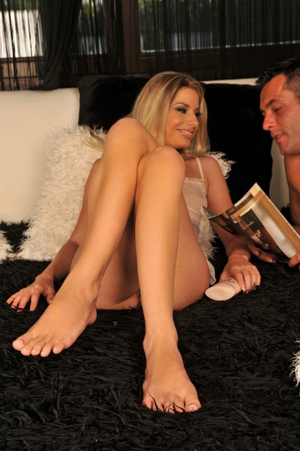 Blonde babe is entertaining a dick with her feet