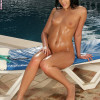 Oiled up sunbather spreads and fingers hot snatch poolside