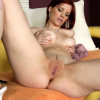 Redhead fondles perfect porcelain breasts and bares pussy
