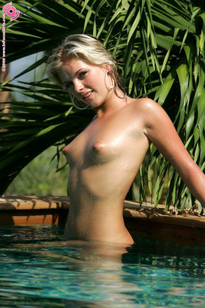 Angelic blonde slips into pool and fondles wet pussy for you
