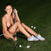 Busty brunette golfer gets naked and dildos pussy on green