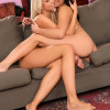 Brunette and blonde strip lap and finger pussies on couch