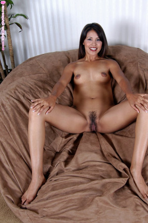 Exotic hottie slowly strips and spreads furry muff on sofa