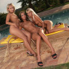 Dazzling ladies drop bikinis and dildo in poolside threesome