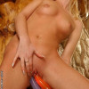 Blonde teen is stuffing two dildos